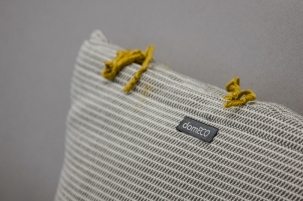 LINEN AND GOLD PIBIONES PILLOWS BY DOMECO + MARIANTONIA URRU   http://www.archilovers.com/projects/206272/dental-studio.html
